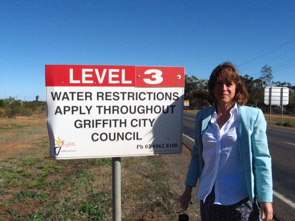 A picture of Anna next to a water restriction advisory sign, taken from our water policy trip to New South Wales in May 2010.